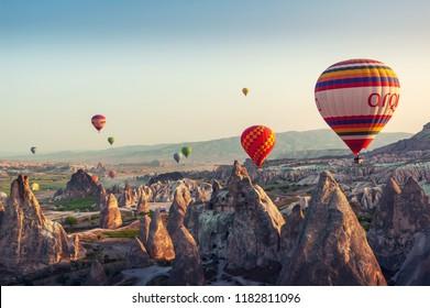 Hot air balloon flying over rock landscape at Cappadocia Turkey at the May 05, 2018