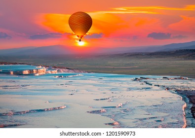 Hot air balloon flying over spectacular pamukkale - Natural travertine pools and terraces in Pamukkale. Cotton castle in southwestern Turkey,