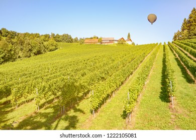 Hot air balloon flying over the vineyards along austrian wine road, Austria Europe