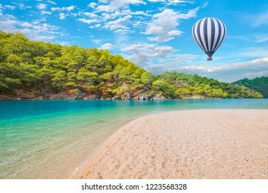 Hot air balloon flying over spectacular oludeniz lagoon