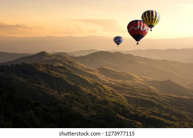 Hot air balloon flying over doi Chang at sunset ,Chiang Rai, Thailand