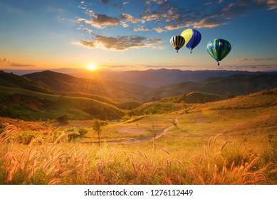 Hot air balloon flying over doi Chang at sunset ,Chiang Rai, Thailand