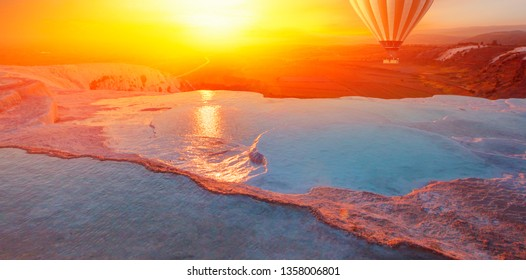 Hot air balloon flying over spectacular pamukkale - Natural travertine pools and terraces in Pamukkale. Cotton castle in southwestern Turkey