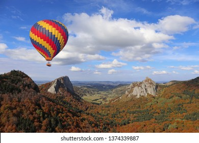 Hot air balloon flying over volcano. Auvergne, France