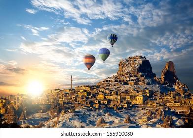 Hot air balloon flying over spectacular Cappadocia