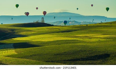 Hot air balloon flying over green field landscape at Cappadocia Turkey