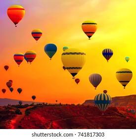 Hot air balloon flying over Cappadocia Goreme National Park Turkey.