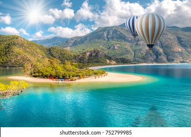 Hot air balloon flying over spectacular oludeniz lagoon