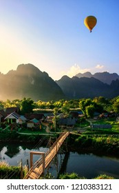 Hot air balloon flying in Vang Vieng, Vientiane Province, Laos. Vang Vieng is a popular destination for adventure tourism in a limestone karst landscape.