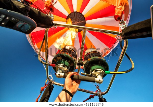 Hot air balloon with gas power accelerators, taking off