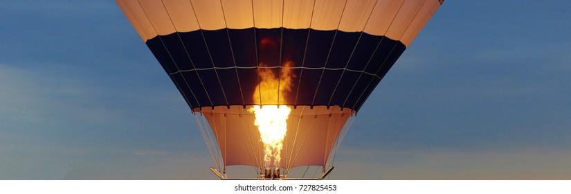 hot air balloon as it is inflated for flight, burning burner