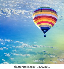 Hot air balloon on sea with cloud