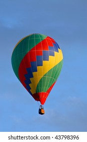 Hot air balloon on sky before landing