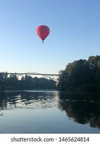 hot air balloon over bridge
