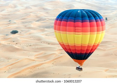 A hot air balloon over desert of the UAE.