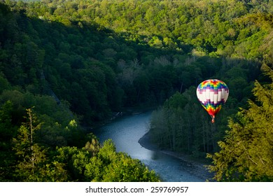 Hot air balloon over the gorge at Letchworth State park on a sunny summer day.