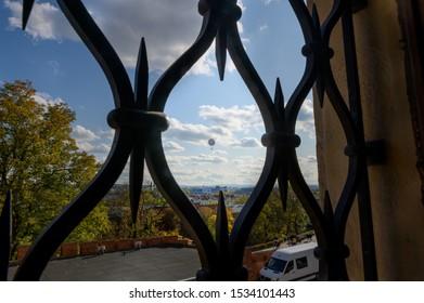 hot air balloon over krakow looking through steel frame window
