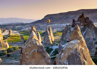 Hot air balloon over landscape of Cappagocia in Turkey