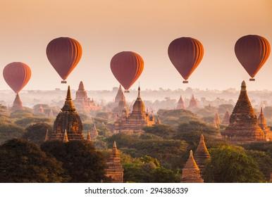 Hot air balloon over plain of Bagan at sunrise, Myanmar