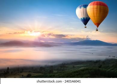 Hot air balloon over sea of mist
