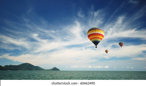 Hot air balloon over the sea