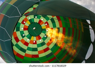 hot air balloon preparing for flight, heating air with fire