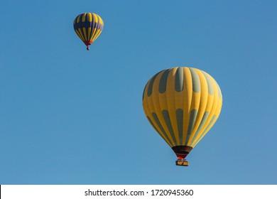 Hot air balloon profiled on deep blue sky