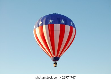 A Hot Air Balloon Rising with a blue sky backdrop