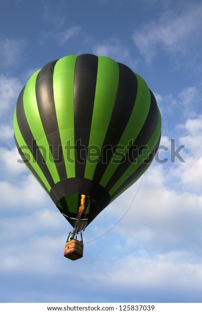 Hot air balloon rising in the sky