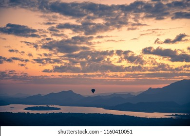 Hot air balloon in the sky, beautiful view of amazing cloudy sunset sky over mountains, summer traveling to Sigiriya, Sri Lanka, South Asia