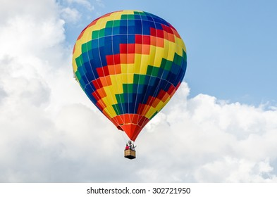 Hot air balloon in the sky with clouds