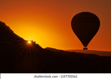 Hot air balloon in the sky during sunrise in Cappadocia