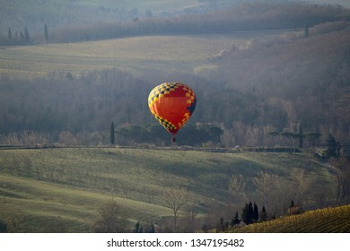 A hot air balloon at sunrise above the Chianti hills south of Florence in Tuscany