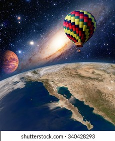 Hot air balloon surreal wonderland fairy tale landscape fantasy planet. Elements of this image furnished by NASA.