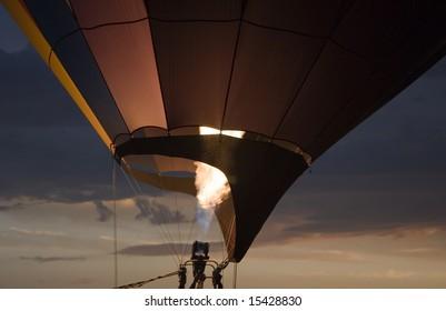 Hot air balloon taking off at sunset