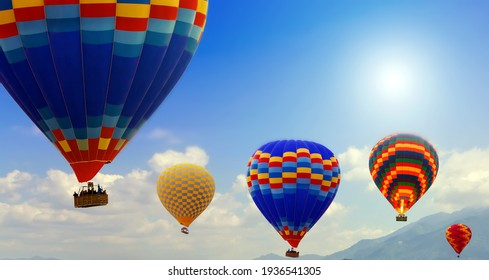 Hot air balloon team flying. Aerial view sun spring blue Sky landscape. Travel concept.