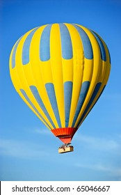 Hot air balloon tour against a blue sky
