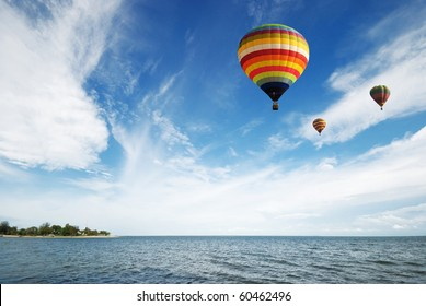 Hot air balloon travel over the sea