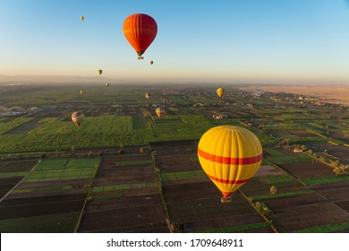 Hot air Balloons above Luxor city in a morning sunrise, Upper Egypt, Africa