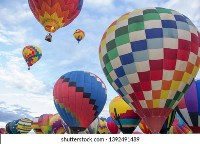 Hot air balloons ascend over Albuquerque, New Mexico, at the International Balloon Fiesta