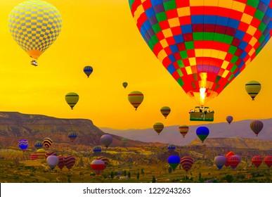 Hot air balloons basket landing in sunrise mountain at Cappadocia Turkey