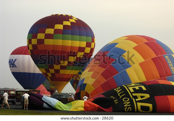 Hot Air Balloons being blown up.