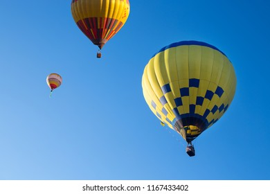 Hot air balloons in the blue summer sky