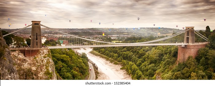 Hot air balloons in early morning lift off behind Clifton suspension bridge