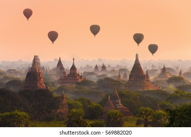 Hot air balloons fly over the ancient pagodas of Bagan