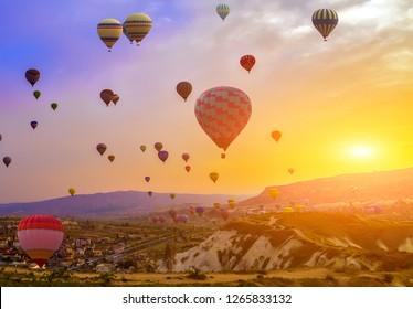 Hot Air balloons flying adventure Mountains landscape sunset Cappadocia, Turkey