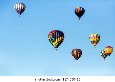 Hot air balloons flying in a beautiful blue clear sky