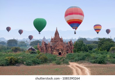 Hot air balloons flying over fields in Bagan, Mandalay division, Myanmar