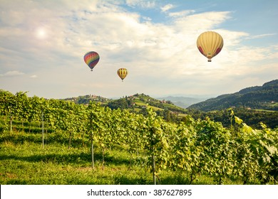 Hot air balloons flying over the vineyards along South Styrian Wine Road, Austria Europe