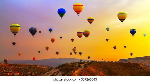 Hot air balloons landing in a mountain